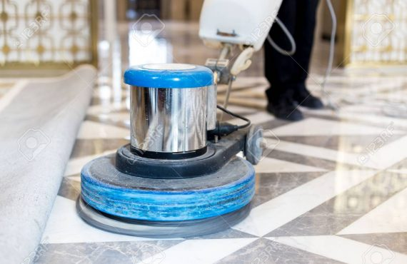67367245-man-polishing-marble-floor-in-modern-office-building